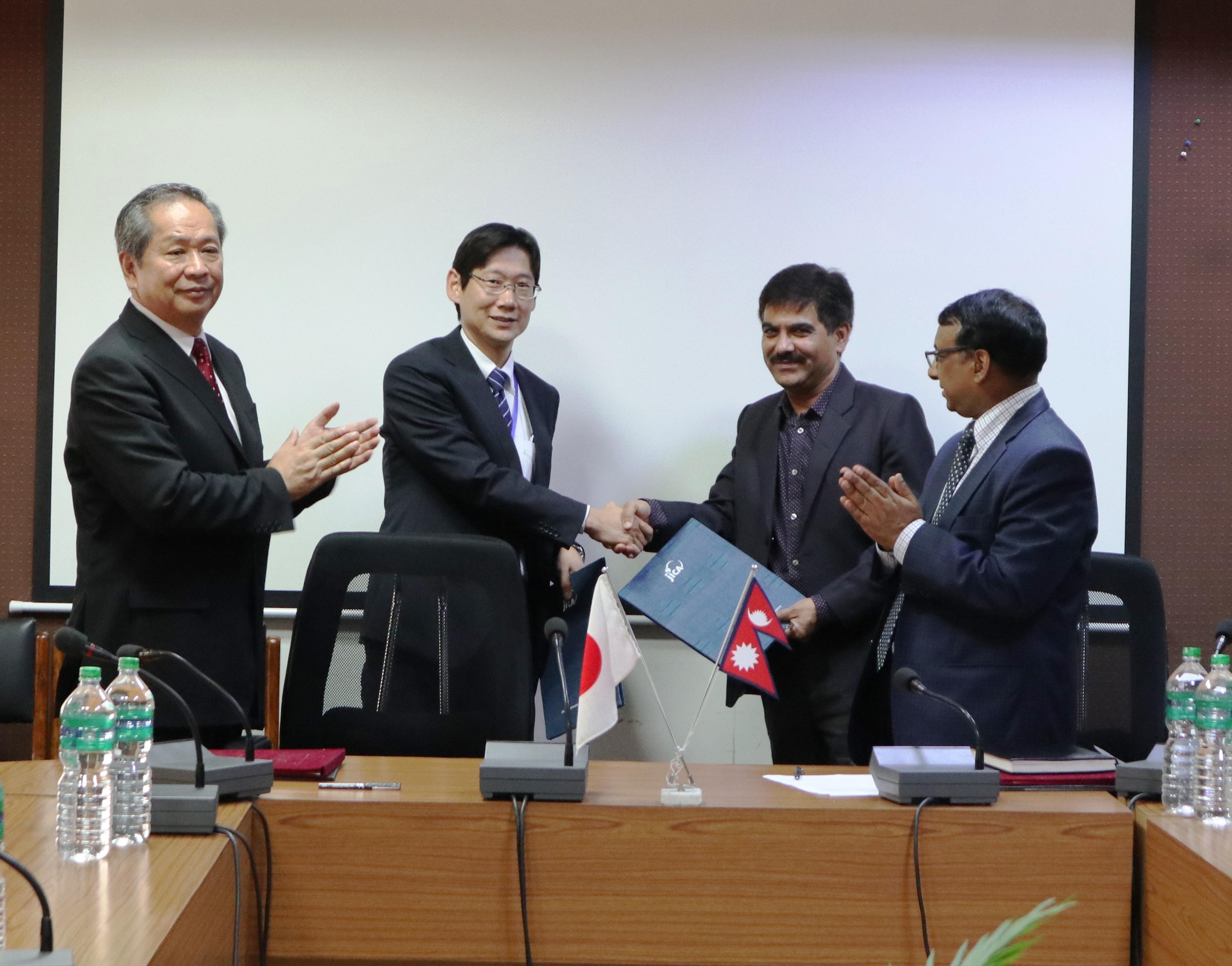 http://nepalitimes.com/assets/uploads/gallery/21d7d-Grant-Agreement-exchanged-between-Mr.-Baikuntha-Aryal-MOF-and-Mr.-Jun-Sakuma-JICA.JPG