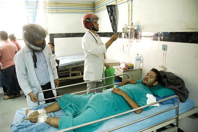 http://nepalitimes.com/assets/uploads/gallery/62e72-Helmet-doctors.jpg