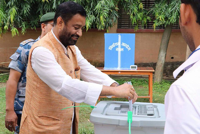 http://nepalitimes.com/assets/uploads/gallery/ba84b-bimalendra-nidhi-voting-in-Dhanusa.jpg
