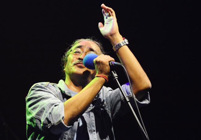 http://nepalitimes.com/assets/uploads/gallery/e001c-Nepathya-frontman-Amrit-Gurung-performing-in-New-York.jpg