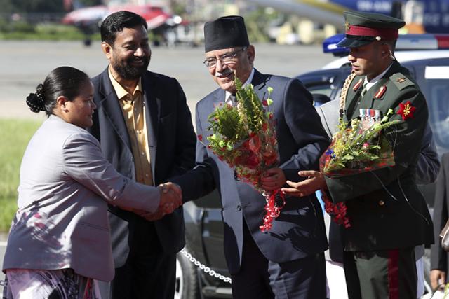 http://nepalitimes.com/assets/uploads/gallery/e8d78-Prachanda-returns-from-India-visit.jpg