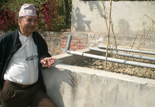 100 YEAR PLAN: Homnath Adhikari of Namsaling in Ilam at a pilot waste-water treatment plant that he helped set up.