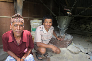 FATHER TO SON: Karna Thapaliya and his youngest son upgraded the traditional water mill of their ancestors to generate 5kW of electricity to sell to 26 households in the neighbourhood.