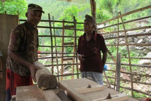 Krishna Shrestha (left) uses power generated by Karna Thapaliya's improved water mill to run a small furniture factory by the banks of the Rosi in Kavre.