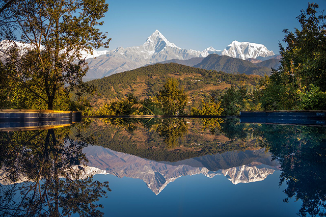 On clear days, the swimming pool at Tiger Mountain Pokhara Lodge offers a stunning reflection of Machapuchre. Photo: Thomas L Kelly
