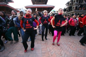 Women wearing the campaign T-shirt lead the rest of the participants in the dance.