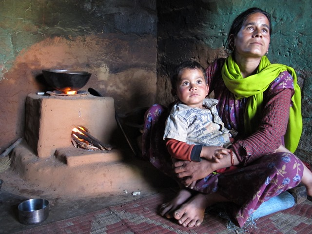 Gauri Devi Bhatt and her son in their kitchen with her Rs 200 smoke-free improved stove that has reduced her daily workload to gather firewood and educed lung and eye infections.