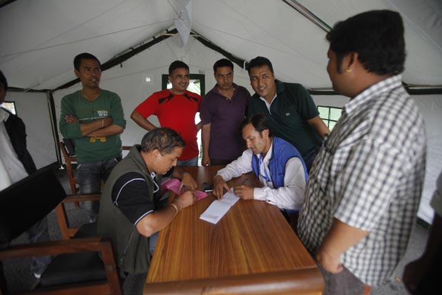 Officials of National Planning Commission work from a tent after the earthquake damaged their office in Singha Darbar