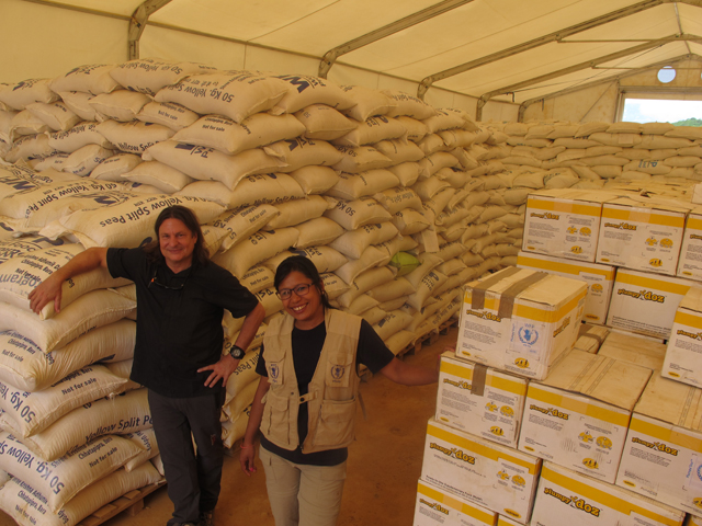 Richard Regan and Chunu Shrestha of WFP at a warehouse in the logistics base in Chautara of Sindhupalchok.