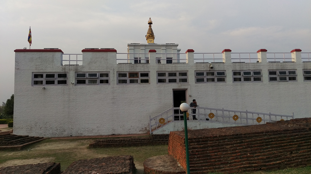 The sal tree which Maya Devi is believed to have held on to while giving birth to Siddhartha and the sacred pond where she washed herself afterwards are still here. The nearby archaeological excavation is housed in a white temple and visitors can look down on the nativity site from a gallery.