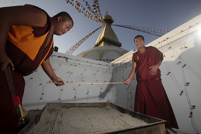 Buddhist monks make a madala during the consecration ceremony of the Boudhanath Stupa.