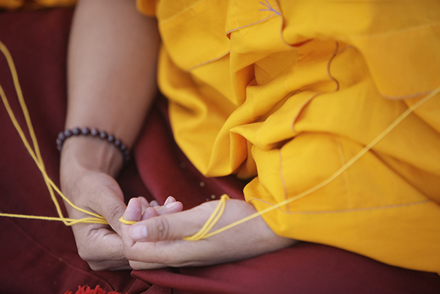 A Buddhist monk performs ritual prayers during the consecration ceremony of Boudhanath Stupa.