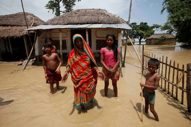 Villagers in Saptari after the floods entered and submerged their homes
