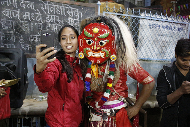 A girl poses for a selfie with a Lakhey.