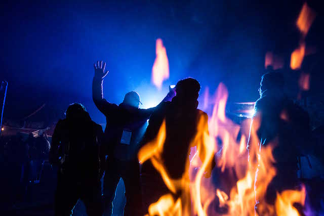 Drenched in alcohol and the smoke of fires burning, the party continued on into the late night.