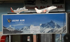A notice at the Agni Air counter in the Kathmandu Domestic Airport announces that all the flights of the day have been cancelled.