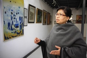 Neera Joshi, botanical artist and curator of the gallery, is responsible for setting up the exhibition.