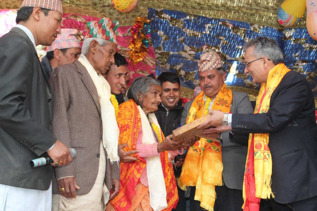 Bal Krishna Dhungel (center) with Baburam Bhattarai at a program in Okhaldhunga two weeks ago. Photo:Nagarik