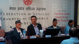Nepali Congress leaders Sushil Koirala and Sher Bahadur Deuba with FNCCI's Suraj Vaidya (centre) at a discussion regarding business and election manifestos on Sunday.