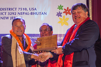 US Ambassador to Nepal Peter W Bodde presents USA-Nepal Humanitarian Award to Daya Ram Maharjan.