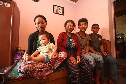 STILL WAITING: (from l-r) Ash Bahadur Gurung's wife Menuka Gurung, mother Samati Gurung, younger brother Shiva Gurung and father Jitra Gurung at Galkopakha.  Credit: BIKRAM RAI
