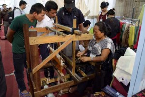 Dev Maya Limbu from Terathum has been actively involved in making caps, mufflers, saaris and cholo using the loom. She demonstrates the making process to the audiences at Nepali times eco fair on Thursday.