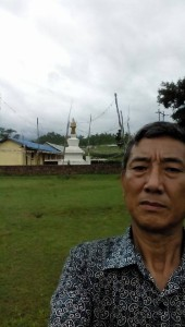Dorji Tsering Sherpa at Bastipur's school and stupa.