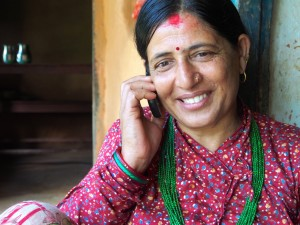 Sita Devi, wife of Surya Mohan Bastola, talking on her mobile phone.