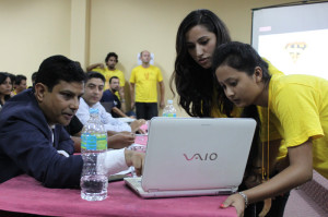 Sunita Thapaliya (left) and Shilu Pradhan discussing their project with Resta Jha, one of the judges.