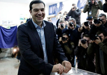 Syriza party leader Alexis Tsipras casts his vote in Athens on 25 January 2015. Photo by Konstantinos Tsakalidis/Corbis
