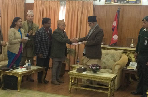 Former Chief Justice Om Bhakta Shrestha submits recommended names for the TRC and the Commission on Disappeared Persons to Prime Minister Sushil Koirala on Monday. Photo by PMO