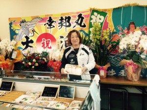 A survivor of Tohoku earthquake and tsunami at her newly opened fish shop.