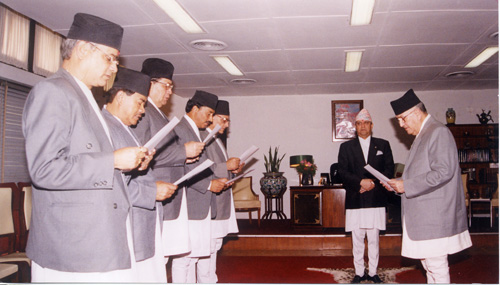 The then Prime Minister Surya Bahadur Thapa swears in the cabinet of ministers in 2004. Photo: Min Bajracharya