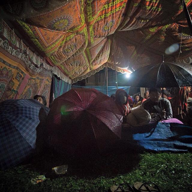 The rain has made life more difficult for locals waiting out the shocks in temporary shelters Pic: Cynthia Choo