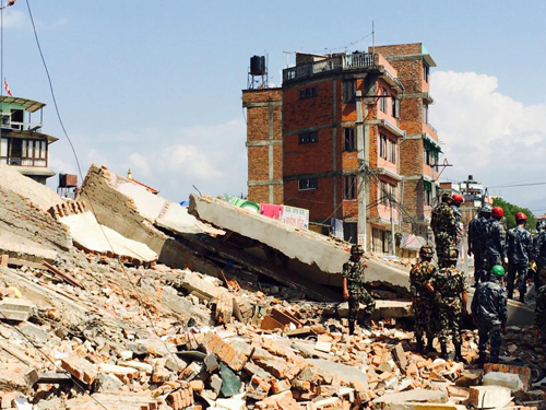A four-storey building collapsed in Nayabazar following the earthquake. People are believed to be under the rubble.  Photo: Dambar Krishna Shrestha