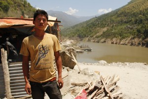 Lanka Tamang stands infront of a makeshift tent he built after his house was destroyed on Saturday. Pic: Bhrikuti Rai