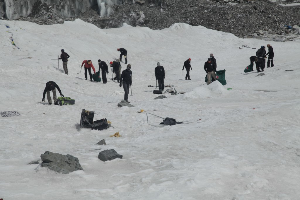 A multinational team cleaning up the Everest Base Camp.