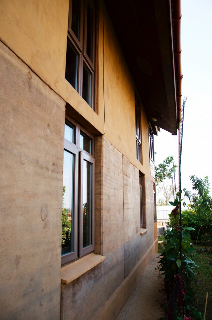 The wall of a home made with rammed earth technology can be attractive and safe.