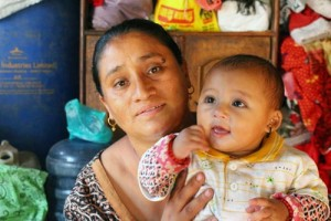 HAPPY FAMILY: Rashmila Awal with her seven-month baby, Sonish, who was pulled out of the rubble of their home in Bhaktapur after 22 hours. Photo: Sahina Shrestha