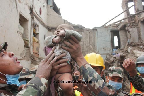 Sonish Awal is found alive after 22 hours under the rubble. Pic: Kathmandu Today