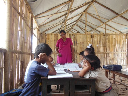 Rita Dulal (centre) teaching her grade one students in the temporary learning centre in Madan Memorial School. Photo: Sonia Awale