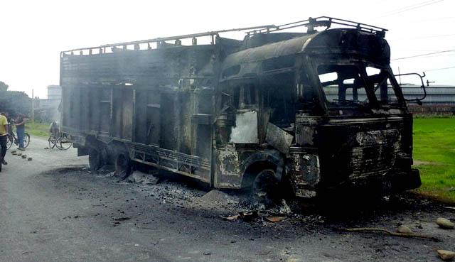 Protestors vandalised two trucks along the east-west highway. Pic: Bidrohi Giri