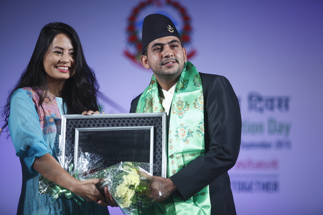 Chiranjeevi Khanal receives the Matthew Preece and Yeshi Choden Lama Young Conservation Leader Award.
