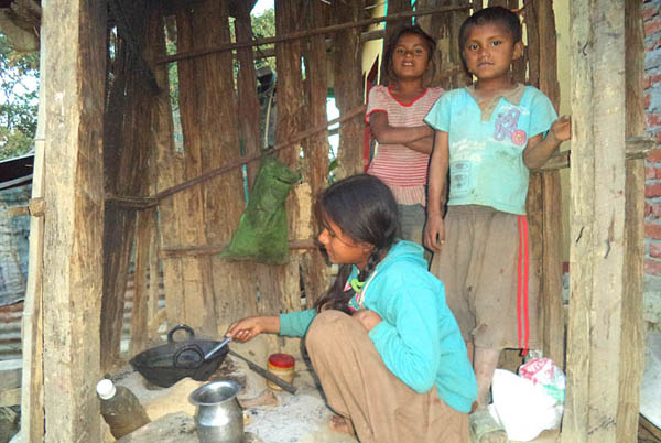 11-year old Manju preparing a meal for her siblings. Pic: Laxmi Bhandari