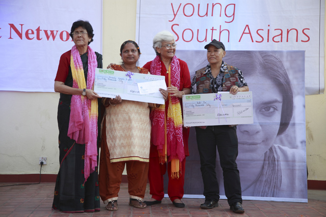 Women's right activist Abha Bhaiya and Kamla Bhasin hand over the Sangatee Grant Award to Nirmala Kumari Gupta and Badri Pun on Monday. Pic: Gopen Rai