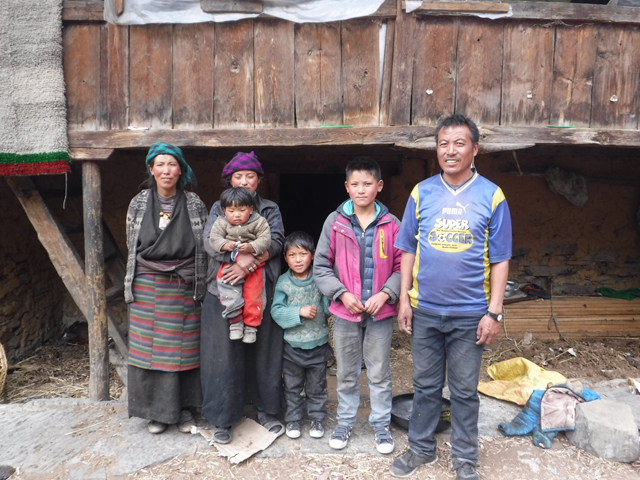 Dara Punjal Lama, (second from right) with his family in Tsum Valley from where he has to walk two days to his school in Philim several times a year across dangerous trails damaged by landslides.
