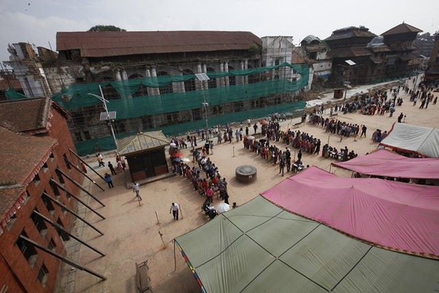 Voters line up outside the polling station in Basantapur.