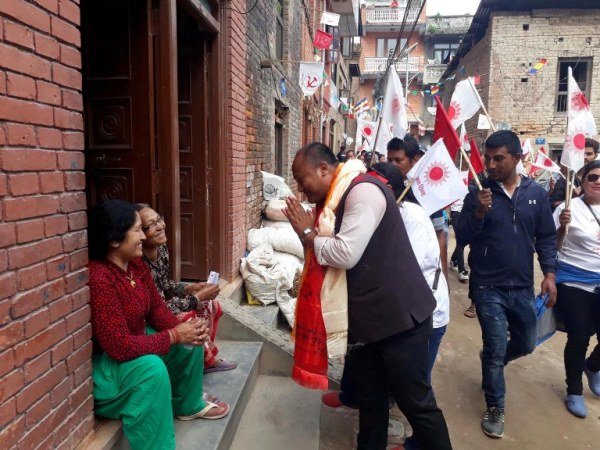 CPN-UML candidate Madansundar Shrestha visits locals of Madhyapur Thimi asking for their vote. Pic: RSS