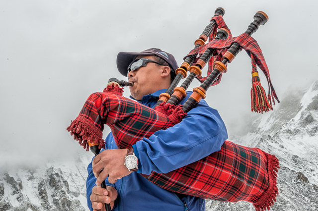KEEPING WATCH: A Gurkha soldier in kilts and playing a bagpipe at Mt Everest Base Camp this month sporting a Loomes watch that will be auctioned to raise money for earthquake survivors in Nepal.