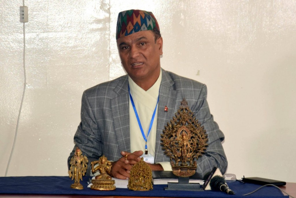 Director General of Department of Archaeology Bhesh Dahal with the stolen statues that were willed back to Nepal by US collector.
